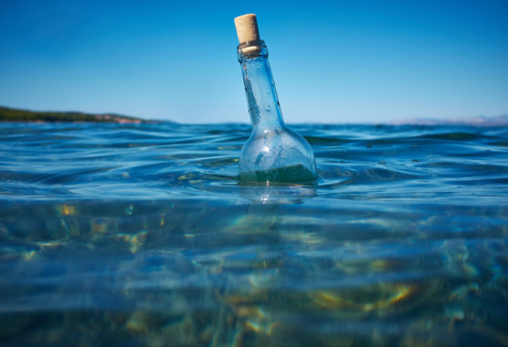 Message in a floating bottle in the ocean.